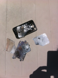 This is what an iPhone looks like after a few minutes in a camp fire